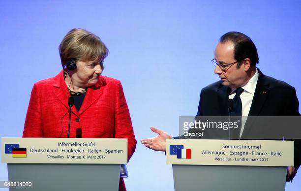 French President Francois Hollande and German Chancellor Angela Merkel attend a press conference after a quadripartite summit gathering heads of...