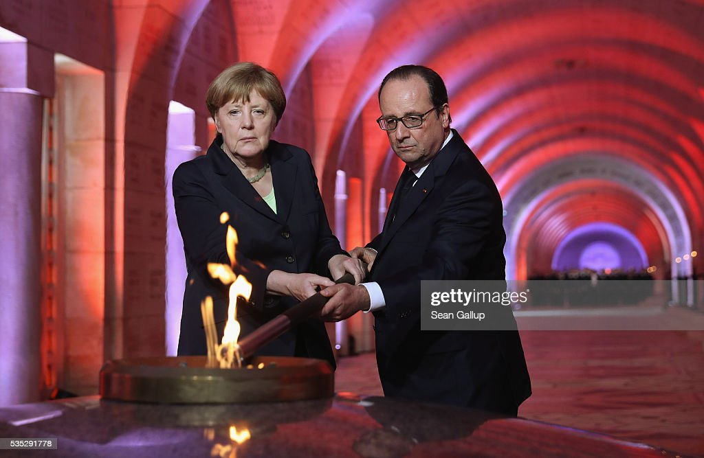 French President Francois Hollande and German Chancellor <a gi-track='captionPersonalityLinkClicked' href=/galleries/search?phrase=Angela+Merkel&family=editorial&specificpeople=202161 ng-click='$event.stopPropagation()'>Angela Merkel</a> light an eternal flame inside the ossuary at Douaumont in memory of the 130,000 soldiers whose remains are buried at the site during ceremonies to commemorate the 100th anniversary of the World War I Battle of Verdun on May 29, 2016 near Verdun, France. The 1916, 10-month battle pitted the French and German armies against one another in a grueling campaign of trench warfare and artillery bombardments that killed a total of approximately 300,000 soldiers. The events today coincide with the 50th anniversary of commemorations held at Verdun by then French President Charles de Gaulle and German Chancellor Konrad Adenauer that paved the way for a new era of peaceful, post-war Franco-German relations.