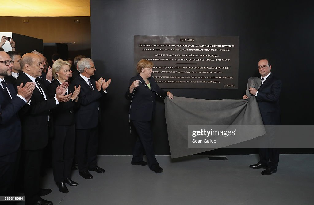 French President Francois Hollande and German Chancellor <a gi-track='captionPersonalityLinkClicked' href=/galleries/search?phrase=Angela+Merkel&family=editorial&specificpeople=202161 ng-click='$event.stopPropagation()'>Angela Merkel</a> unveil an inauguration plaque at the Verdun Memorial during ceremonies to commemorate the 100th anniversary of the World War I Battle of Verdun on May 29, 2016 near Verdun, France. The 1916, 10-month battle pitted the French and German armies against one another in a grueling campaign of trench warfare and artillery bombardments that killed a total of approximately 300,000 soldiers. The events today coincide with the 50th anniversary of commemorations held at Verdun by then French President Charles de Gaulle and German Chancellor Konrad Adenauer that paved the way for a new era of peaceful, post-war Franco-German relations.