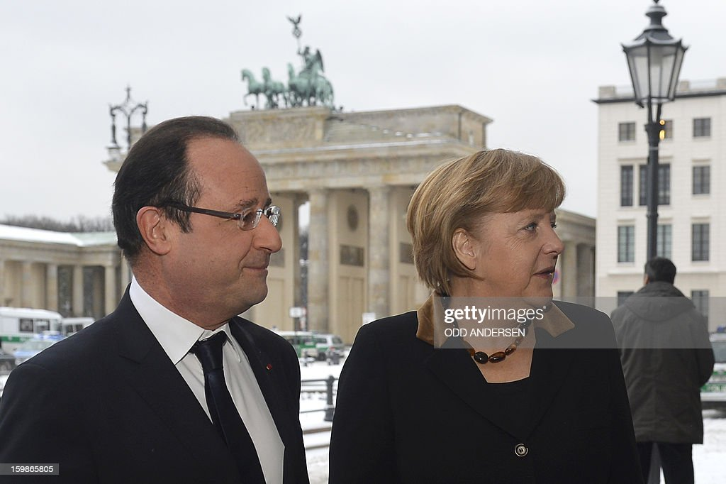 French President Francois Hollande (L) and German Chancellor Angela Merkel (R) arrive at the French Embassy near the Brandenburg Gate in Berlin on January 22, 2013 for a meeting as part of the celebration to mark 50 years since the Elysee Treaty launched after WWII the French-German cooperation. In signing the landmark treaty on January 22, 1963, then French president Charles de Gaulle and West German chancellor Konrad Adenauer sealed a new era of reconciliation between the former foes which has since driven European unity.