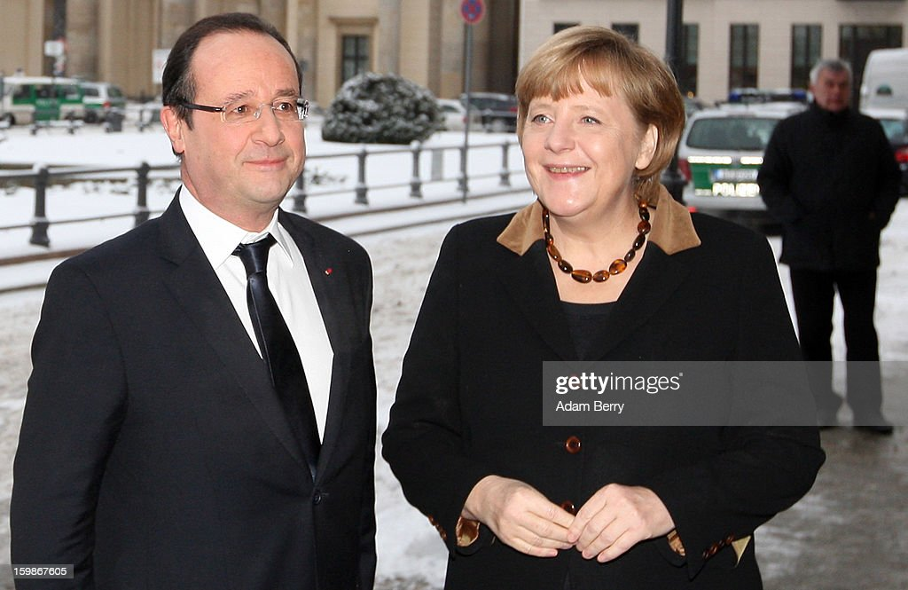 French President Francois Hollande (l.) and German Chancellor Angela Merkel arrive at the French embassy in front of the Brandenburg Gate during the 50th anniversary celebration of the Elysee Treaty on January 22, 2013 in Berlin, Germany. The treaty, concluded in 1963 by Charles de Gaulle and Konrad Adenauer in the Elysee Palace in Paris, set a new tone of reconciliation between France and Germany, and called for consultations between the two countries to come to a common stance on policies affecting the most important partners in Europe as well as the rest of the region. Since its establishment, the document for improved bilateral relations has been seen by many as the driving force behind European integration.