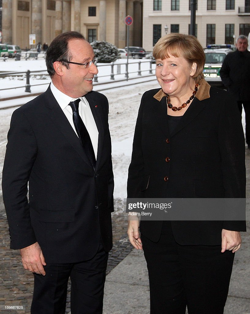 French President Francois Hollande (L) and German Chancellor Angela Merkel arrive at the French embassy in front of the Brandenburg Gate during the 50th anniversary celebration of the Elysee Treaty on January 22, 2013 in Berlin, Germany. The treaty, concluded in 1963 by Charles de Gaulle and Konrad Adenauer in the Elysee Palace in Paris, set a new tone of reconciliation between France and Germany, and called for consultations between the two countries to come to a common stance on policies affecting the most important partners in Europe as well as the rest of the region. Since its establishment, the document for improved bilateral relations has been seen by many as the driving force behind European integration.