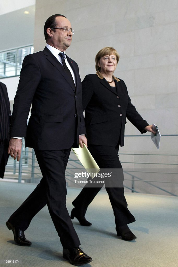 French President Francois Hollande (L) and German Chancellor Angela Merkel arrive at a press conference at the Chancellery during the 50th anniversary celebration of the Elysee Treaty on January 22, 2013 in Berlin, Germany. The treaty, concluded in 1963 by Charles de Gaulle and Konrad Adenauer in the Elysee Palace in Paris, set a new tone of reconciliation between France and Germany, and called for consultations between the two countries to come to a common stance on policies affecting the most important partners in Europe as well as the rest of the region. Since its establishment, the document for improved bilateral relations has been seen by many as the driving force behind European integration.