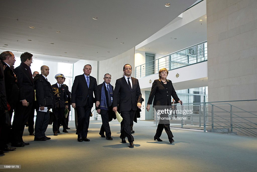 French President Francois Hollande (2nd R) and German Chancellor Angela Merkel (R) arrive at a press conference at the Chancellery during the 50th anniversary celebration of the Elysee Treaty on January 22, 2013 in Berlin, Germany. The treaty, concluded in 1963 by Charles de Gaulle and Konrad Adenauer in the Elysee Palace in Paris, set a new tone of reconciliation between France and Germany, and called for consultations between the two countries to come to a common stance on policies affecting the most important partners in Europe as well as the rest of the region. Since its establishment, the document for improved bilateral relations has been seen by many as the driving force behind European integration.