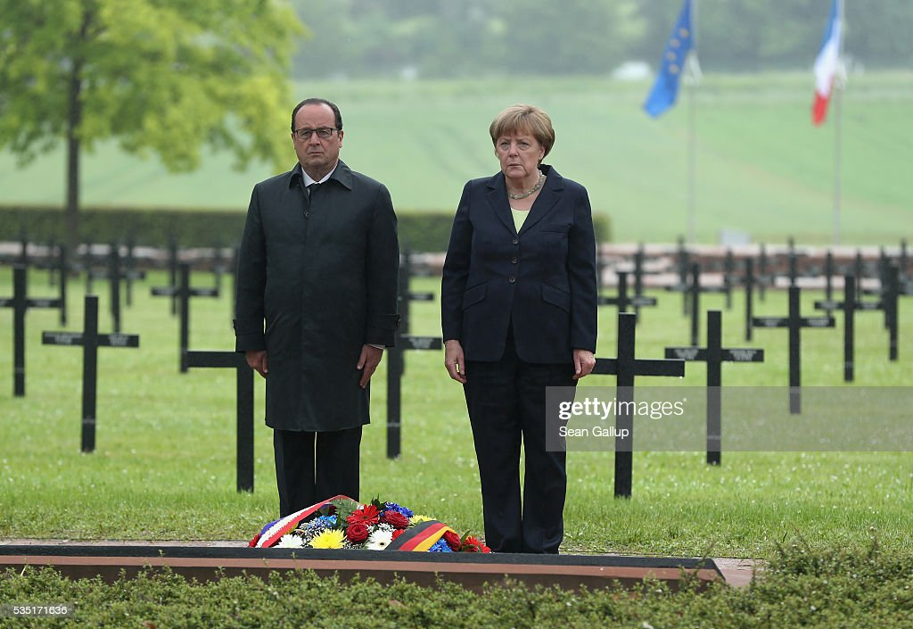 French President Francois Hollande and German Chancellor <a gi-track='captionPersonalityLinkClicked' href=/galleries/search?phrase=Angela+Merkel&family=editorial&specificpeople=202161 ng-click='$event.stopPropagation()'>Angela Merkel</a> stand at a memorial after laying a wreath at the German World War I military cemetery at Consonvoye during ceremonies to commemorate the 100th anniversary of the World War I Battle of Verdun on May 29, 2016 near Verdun, France. The 1916, 10-month battle pitted the French and German armies against one another in a grueling campaign of trench warfare and artillery bombardments that killed a total of approximately 300,000 soldiers. The events today coincide with the 50th anniversary of commemorations held at Verdun by then French President Charles de Gaulle and German Chancellor Konrad Adenauer that paved the way for a new era of peaceful, post-war Franco-German relations.