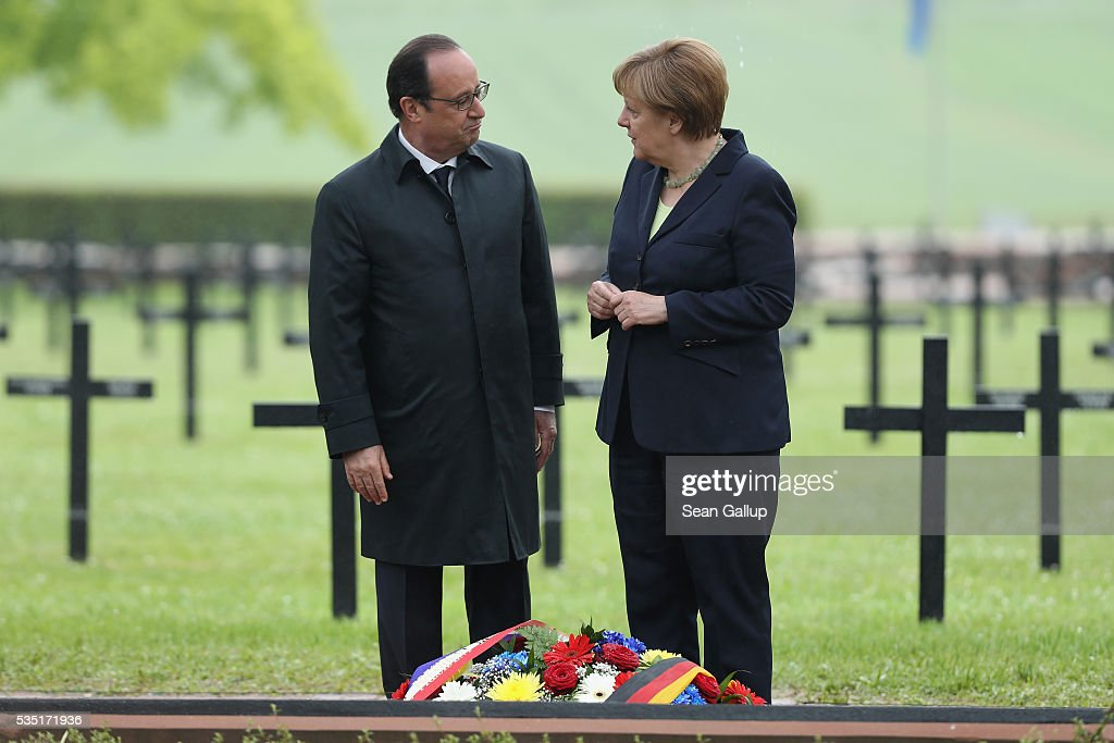 French President Francois Hollande and German Chancellor Angela Merkel stand at a memorial after laying a wreath at the German World War I military cemetery at Consonvoye during ceremonies to commemorate the 100th anniversary of the World War I Battle of Verdun on May 29, 2016 near Verdun, France. The 1916, 10-month battle pitted the French and German armies against one another in a grueling campaign of trench warfare and artillery bombardments that killed a total of approximately 300,000 soldiers. The events today coincide with the 50th anniversary of commemorations held at Verdun by then French President Charles de Gaulle and German Chancellor Konrad Adenauer that paved the way for a new era of peaceful, post-war Franco-German relations.