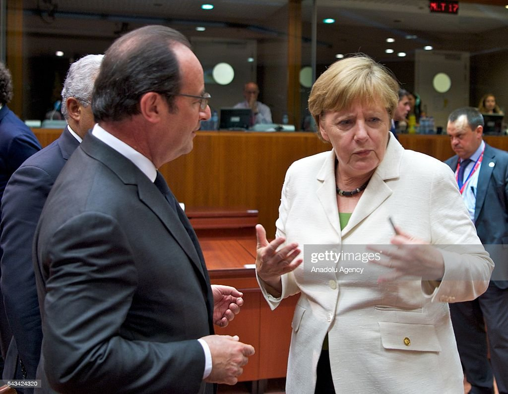 French president Francois Hollande (L) and German Chancellor Angela Merkel (R) attend EU Leaders Summit at the European Union headquarters in Brussels, Belgium on June 28, 2016.