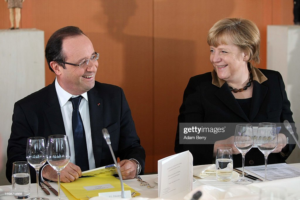French President Francois Hollande (L)and German Chancellor Angela Merkel arrive for a joint council meeting at the German federal chancellery during the 50th anniversary celebration of the Elysee Treaty on January 22, 2013 in Berlin, Germany. The treaty, concluded in 1963 by Charles de Gaulle and Konrad Adenauer in the Elysee Palace in Paris, set a new tone of reconciliation between France and Germany, and called for consultations between the two countries to come to a common stance on policies affecting the most important partners in Europe as well as the rest of the region. Since its establishment, the document for improved bilateral relations has been seen by many as the driving force behind European integration.