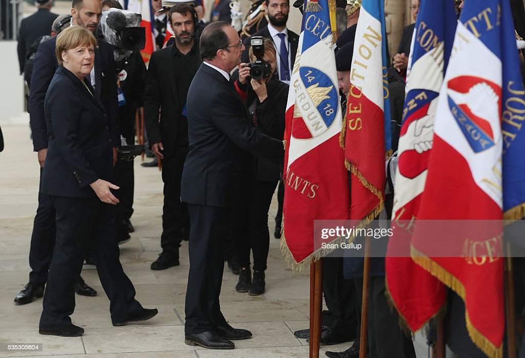 French President Francois Hollande and German Chancellor Angela Merkel gret French military veterans during ceremonies to commemorate the 100th anniversary of the World War I Battle of Verdun at the Douaumont cemetery on May 29, 2016 near Verdun, France. The 1916, 10-month battle pitted the French and German armies against one another in a grueling campaign of trench warfare and artillery bombardments that killed a total of approximately 300,000 soldiers. The events today coincide with the 50th anniversary of commemorations held at Verdun by then French President Charles de Gaulle and German Chancellor Konrad Adenauer that paved the way for a new era of peaceful, post-war Franco-German relations.