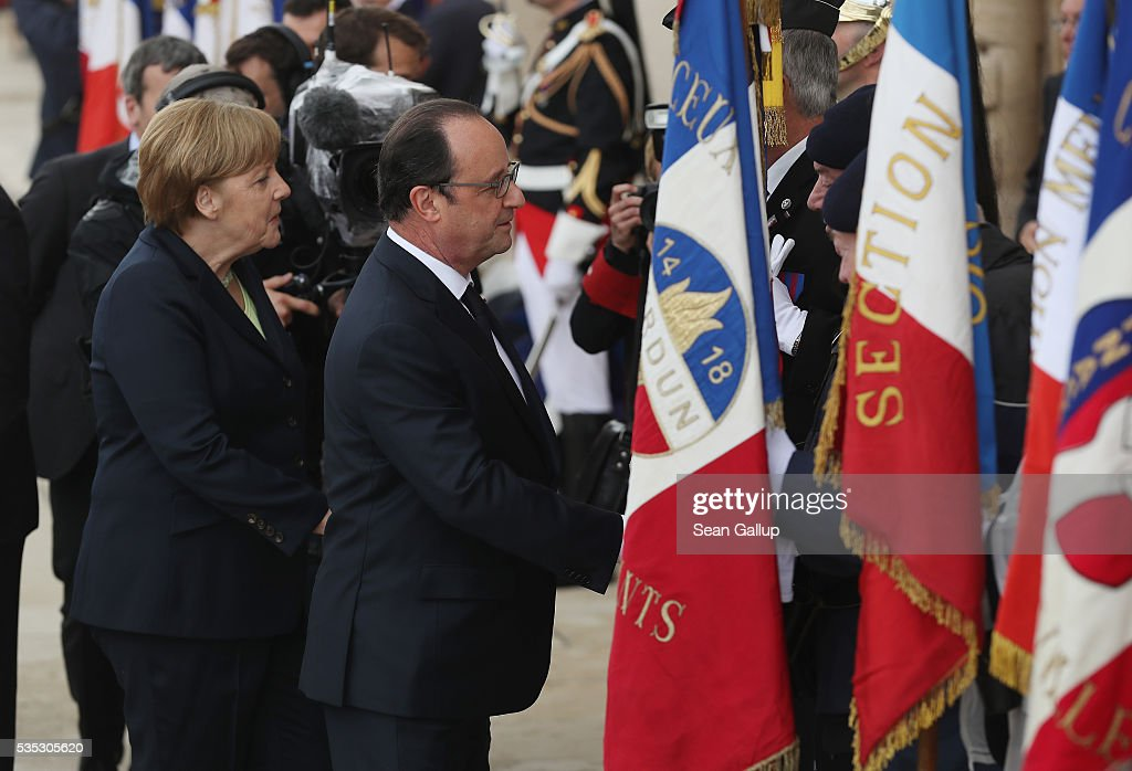 French President Francois Hollande and German Chancellor <a gi-track='captionPersonalityLinkClicked' href=/galleries/search?phrase=Angela+Merkel&family=editorial&specificpeople=202161 ng-click='$event.stopPropagation()'>Angela Merkel</a> gret French military veterans during ceremonies to commemorate the 100th anniversary of the World War I Battle of Verdun at the Douaumont cemetery on May 29, 2016 near Verdun, France. The 1916, 10-month battle pitted the French and German armies against one another in a grueling campaign of trench warfare and artillery bombardments that killed a total of approximately 300,000 soldiers. The events today coincide with the 50th anniversary of commemorations held at Verdun by then French President Charles de Gaulle and German Chancellor Konrad Adenauer that paved the way for a new era of peaceful, post-war Franco-German relations.