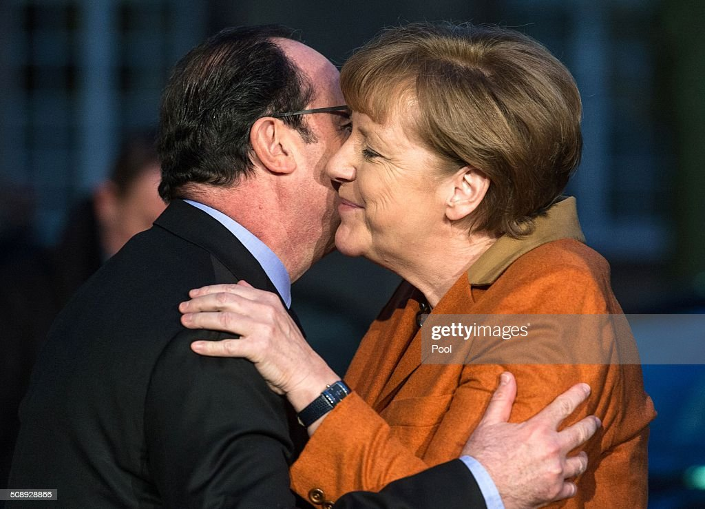 French President Francois Hollande (L) and German Chancellor Angela Merkel hug each other at the Prefecture in Strasbourg, on February 7, 2016, before a meeting about the migrants crisis and the 'Brexit'. The meeting hosted by European Parliament president Martin Schulz takes place on the eve of the trip to Turkey of the German Chancellor in an attempt to solve the refugee issue. / AFP / POOL / Patrick Seeger/POOL