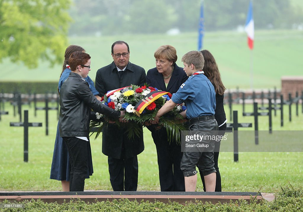 French President Francois Hollande and German Chancellor Angela Merkel lay a wreath together with French and German children at the German World War I military cemetery at Consonvoye during ceremonies to commemorate the 100th anniversary of the World War I Battle of Verdun on May 29, 2016 near Verdun, France. The 1916, 10-month battle pitted the French and German armies against one another in a grueling campaign of trench warfare and artillery bombardments that killed a total of approximately 300,000 soldiers. The events today coincide with the 50th anniversary of commemorations held at Verdun by then French President Charles de Gaulle and German Chancellor Konrad Adenauer that paved the way for a new era of peaceful, post-war Franco-German relations.