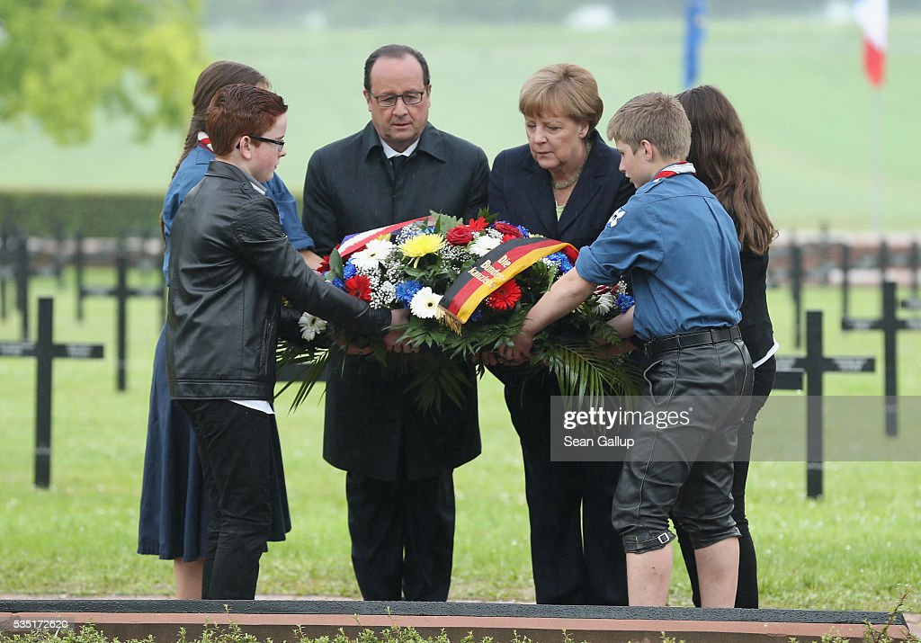 French President Francois Hollande and German Chancellor <a gi-track='captionPersonalityLinkClicked' href=/galleries/search?phrase=Angela+Merkel&family=editorial&specificpeople=202161 ng-click='$event.stopPropagation()'>Angela Merkel</a> lay a wreath together with French and German children at the German World War I military cemetery at Consonvoye during ceremonies to commemorate the 100th anniversary of the World War I Battle of Verdun on May 29, 2016 near Verdun, France. The 1916, 10-month battle pitted the French and German armies against one another in a grueling campaign of trench warfare and artillery bombardments that killed a total of approximately 300,000 soldiers. The events today coincide with the 50th anniversary of commemorations held at Verdun by then French President Charles de Gaulle and German Chancellor Konrad Adenauer that paved the way for a new era of peaceful, post-war Franco-German relations.