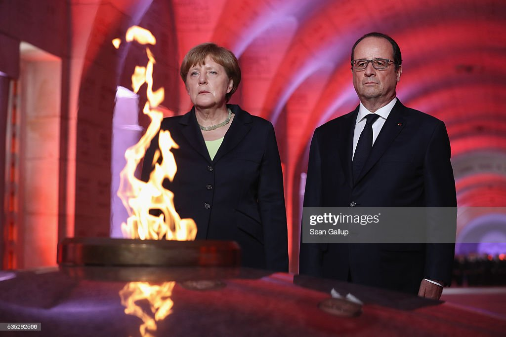 French President Francois Hollande and German Chancellor <a gi-track='captionPersonalityLinkClicked' href=/galleries/search?phrase=Angela+Merkel&family=editorial&specificpeople=202161 ng-click='$event.stopPropagation()'>Angela Merkel</a> look on after lighting an eternal flame inside the ossuary at Douaumont in memory of the 130,000 soldiers whose remains are buried at the site during ceremonies to commemorate the 100th anniversary of the World War I Battle of Verdun on May 29, 2016 near Verdun, France. The 1916, 10-month battle pitted the French and German armies against one another in a grueling campaign of trench warfare and artillery bombardments that killed a total of approximately 300,000 soldiers. The events today coincide with the 50th anniversary of commemorations held at Verdun by then French President Charles de Gaulle and German Chancellor Konrad Adenauer that paved the way for a new era of peaceful, post-war Franco-German relations.