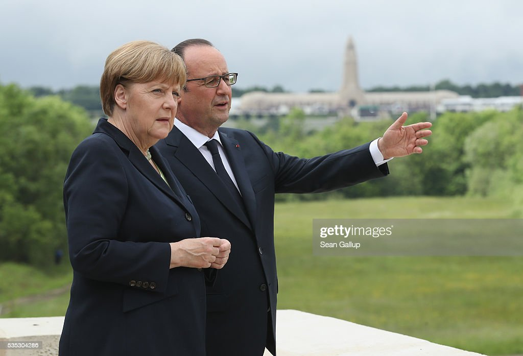 French President Francois Hollande and German Chancellor <a gi-track='captionPersonalityLinkClicked' href=/galleries/search?phrase=Angela+Merkel&family=editorial&specificpeople=202161 ng-click='$event.stopPropagation()'>Angela Merkel</a> look out from the terrace of the Verdun Memorial at the former Verdun battlefields as the ossuary of Douaumont is visible behind during ceremonies to commemorate the 100th anniversary of the World War I Battle of Verdun on May 29, 2016 near Verdun, France. The 1916, 10-month battle pitted the French and German armies against one another in a grueling campaign of trench warfare and artillery bombardments that killed a total of approximately 300,000 soldiers. The events today coincide with the 50th anniversary of commemorations held at Verdun by then French President Charles de Gaulle and German Chancellor Konrad Adenauer that paved the way for a new era of peaceful, post-war Franco-German relations.