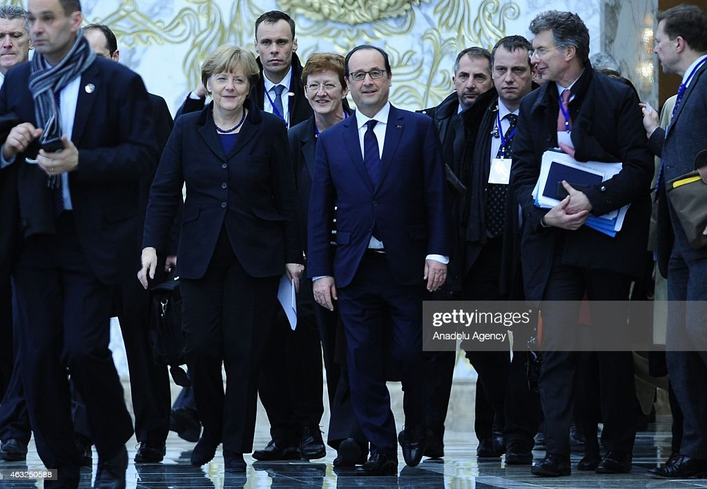 French President Francois Hollande and German Chancellor Angela Merkel attend peace talks over the crisis in Ukraine on February 12 2015 in Minsk...