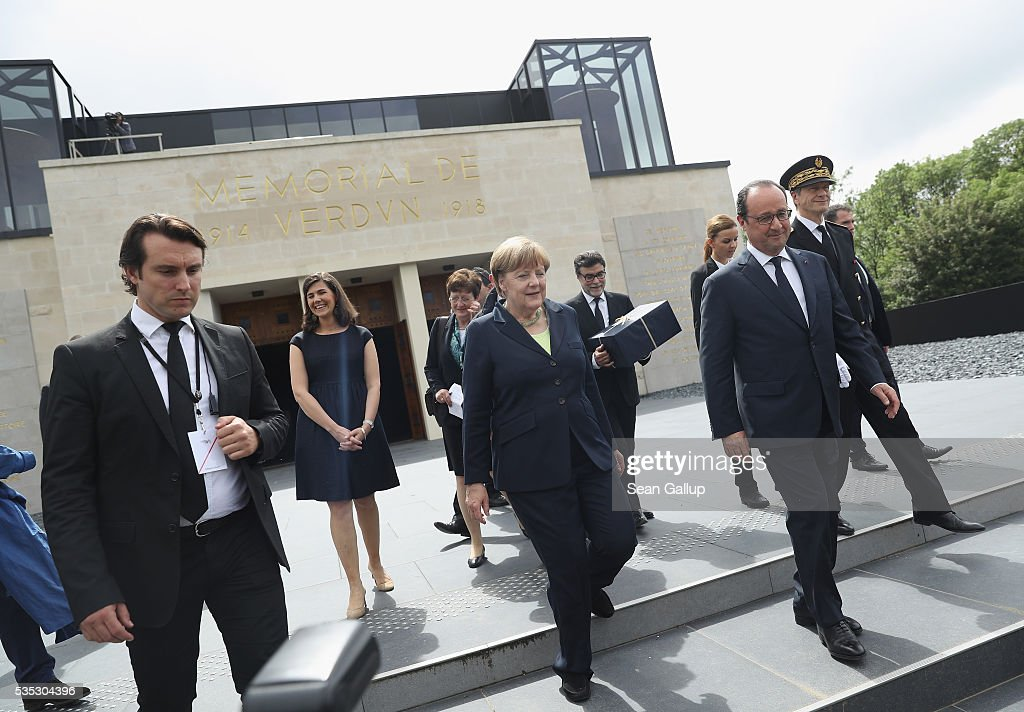 French President Francois Hollande and German Chancellor <a gi-track='captionPersonalityLinkClicked' href=/galleries/search?phrase=Angela+Merkel&family=editorial&specificpeople=202161 ng-click='$event.stopPropagation()'>Angela Merkel</a> depart after visiting the Verdun Memorial during ceremonies to commemorate the 100th anniversary of the World War I Battle of Verdun on May 29, 2016 near Verdun, France. The 1916, 10-month battle pitted the French and German armies against one another in a grueling campaign of trench warfare and artillery bombardments that killed a total of approximately 300,000 soldiers. The events today coincide with the 50th anniversary of commemorations held at Verdun by then French President Charles de Gaulle and German Chancellor Konrad Adenauer that paved the way for a new era of peaceful, post-war Franco-German relations.