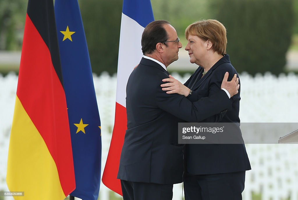 French President Francois Hollande and German Chancellor Angela Merkel embrace after Merkel spoke during ceremonies to commemorate the 100th anniversary of the World War I Battle of Verdun at the Douaumont cemetery on May 29, 2016 near Verdun, France. The 1916, 10-month battle pitted the French and German armies against one another in a grueling campaign of trench warfare and artillery bombardments that killed a total of approximately 300,000 soldiers. The events today coincide with the 50th anniversary of commemorations held at Verdun by then French President Charles de Gaulle and German Chancellor Konrad Adenauer that paved the way for a new era of peaceful, post-war Franco-German relations.