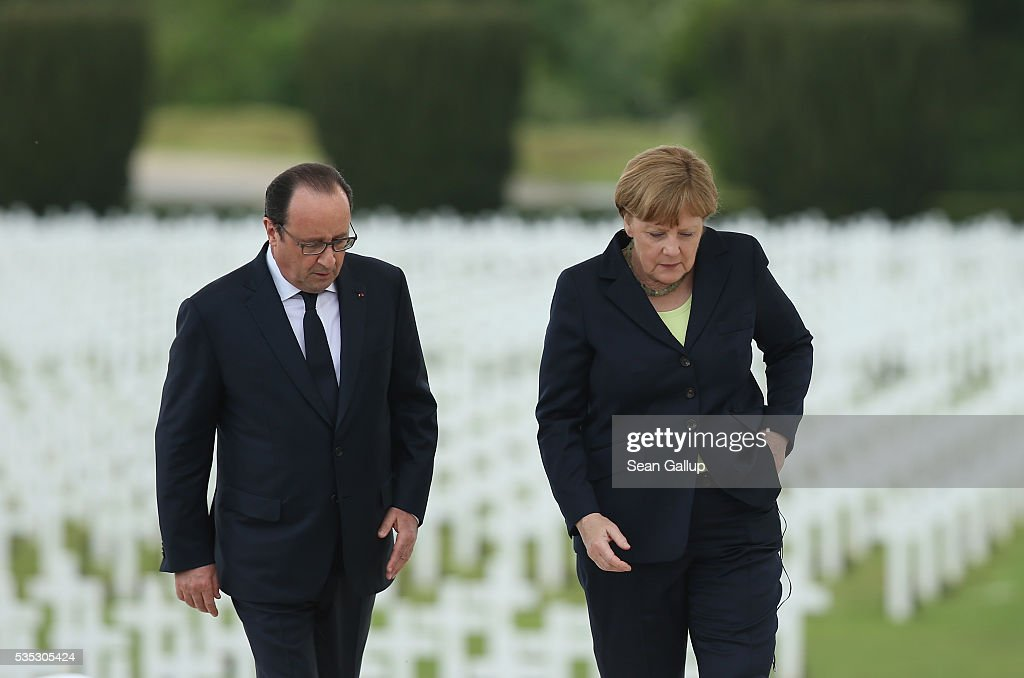 French President Francois Hollande and German Chancellor Angela Merkel depart after speaking during ceremonies to commemorate the 100th anniversary of the World War I Battle of Verdun at the Douaumont cemetery on May 29, 2016 near Verdun, France. The 1916, 10-month battle pitted the French and German armies against one another in a grueling campaign of trench warfare and artillery bombardments that killed a total of approximately 300,000 soldiers. The events today coincide with the 50th anniversary of commemorations held at Verdun by then French President Charles de Gaulle and German Chancellor Konrad Adenauer that paved the way for a new era of peaceful, post-war Franco-German relations.