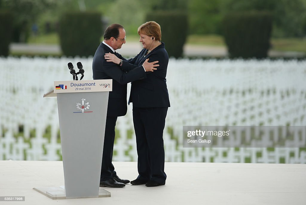 French President Francois Hollande and German Chancellor Angela Merkel embrace after speaking during ceremonies to commemorate the 100th anniversary of the World War I Battle of Verdun at the Douaumont cemetery on May 29, 2016 near Verdun, France. The 1916, 10-month battle pitted the French and German armies against one another in a grueling campaign of trench warfare and artillery bombardments that killed a total of approximately 300,000 soldiers. The events today coincide with the 50th anniversary of commemorations held at Verdun by then French President Charles de Gaulle and German Chancellor Konrad Adenauer that paved the way for a new era of peaceful, post-war Franco-German relations.