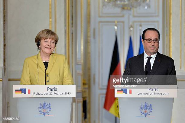 French President Francois Hollande and German Chancellor Angela Merkel adress the press after their meeting at Elysee Palace on February 20 2015 in...