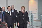 French President Francois Hollande and German Chancellor Angela Merkel arrive to give a press conference at the Chancellery on January 22 2013 in...