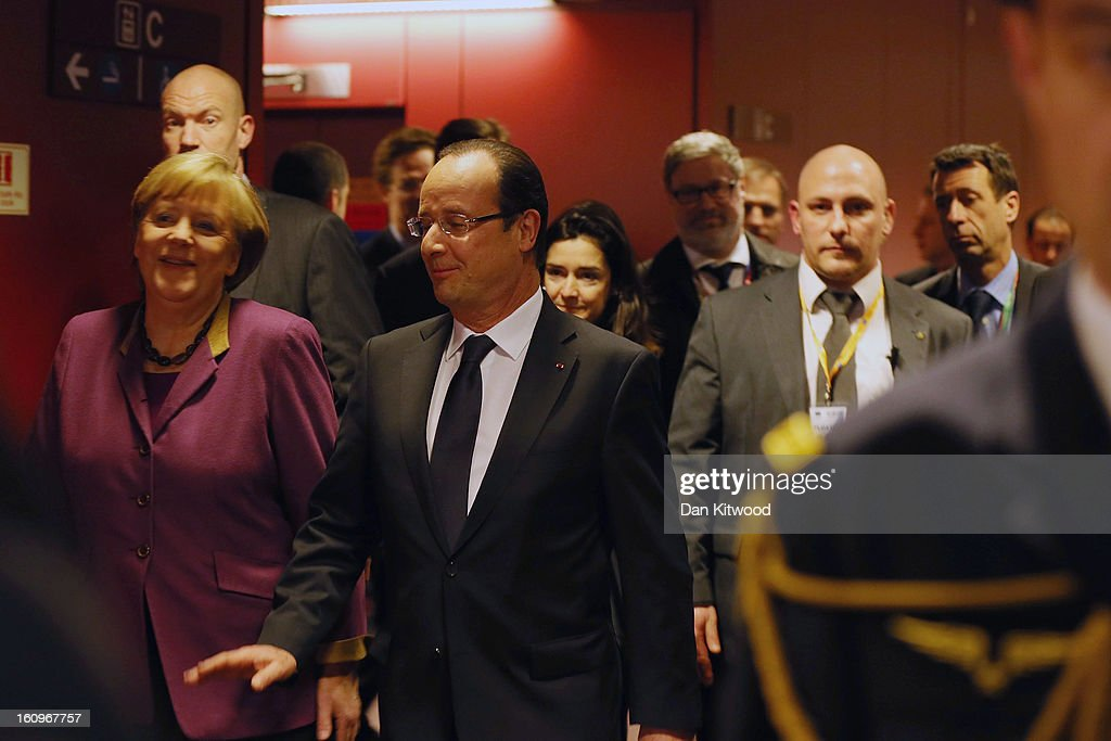 French President Francois Hollande (R) and German Chancellor <a gi-track='captionPersonalityLinkClicked' href=/galleries/search?phrase=Angela+Merkel&family=editorial&specificpeople=202161 ng-click='$event.stopPropagation()'>Angela Merkel</a> (L) arrive to address the media at the headquarters of the Council after reaching a deal on the budget for 2014-20 on February 8, 2013 in Brussels, Belgium. EU leaders have set out the framework for agreeing on a 2014-2020 EU budget, during talks that continued through the night at the European Council meetings in Brussels. The historic deal would see a 34.4 billion Euros cut to EU spending over the next 7 year period.