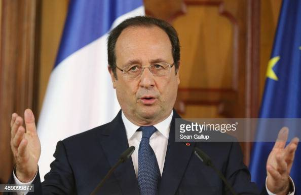 French President Francois Hollande and German Chancellor Angela Merkel speak to the media after talks that included the situtation in Ukraine on May...