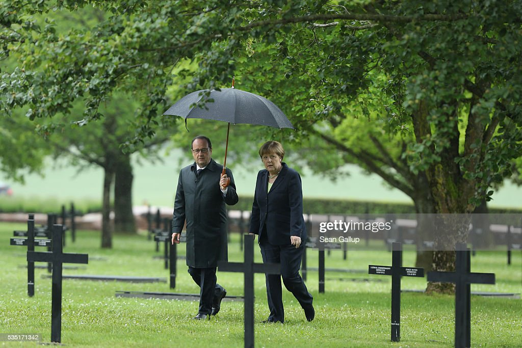 French President Francois Hollande and German Chancellor Angela Merkel arrive to lay a wreath at the German World War I military cemetery at Consonvoye during ceremonies to commemorate the 100th anniversary of the World War I Battle of Verdun on May 29, 2016 near Verdun, France. The 1916, 10-month battle pitted the French and German armies against one another in a grueling campaign of trench warfare and artillery bombardments that killed a total of approximately 300,000 soldiers. The events today coincide with the 50th anniversary of commemorations held at Verdun by then French President Charles de Gaulle and German Chancellor Konrad Adenauer that paved the way for a new era of peaceful, post-war Franco-German relations.