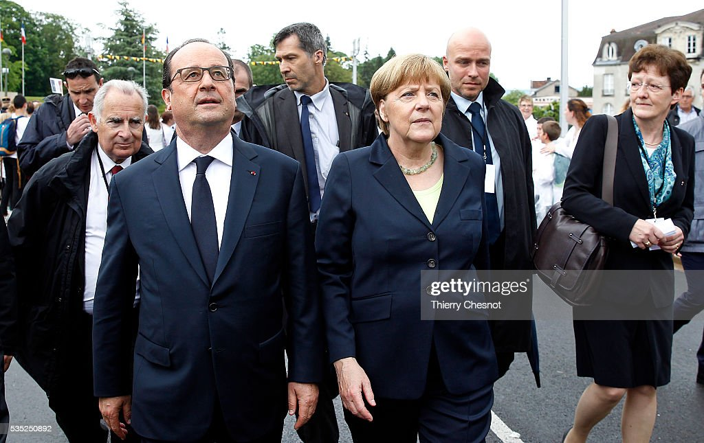 French President Francois Hollande and German Chancellor <a gi-track='captionPersonalityLinkClicked' href=/galleries/search?phrase=Angela+Merkel&family=editorial&specificpeople=202161 ng-click='$event.stopPropagation()'>Angela Merkel</a> arrive to lay a wreath to commemorate the 100th anniversary of the World War I Battle of Verdun on May 29, 2016 near Verdun, France. The 1916, 10-month battle pitted the French and German armies against one another in a gruelling campaign of trench warfare and artillery bombardments that killed a total of approximately 300,000 soldiers. The events today coincide with the 50th anniversary of commemorations held at Verdun by then French President Charles de Gaulle and German Chancellor Konrad Adenauer that paved the way for a new era of peaceful, post-war Franco-German relations.