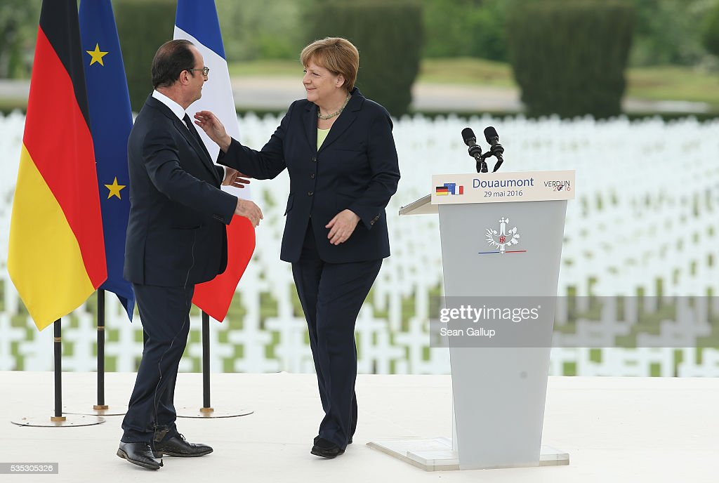 French President Francois Hollande and German Chancellor Angela Merkel prepare to embrace after Merkel spoke during ceremonies to commemorate the 100th anniversary of the World War I Battle of Verdun at the Douaumont cemetery on May 29, 2016 near Verdun, France. The 1916, 10-month battle pitted the French and German armies against one another in a grueling campaign of trench warfare and artillery bombardments that killed a total of approximately 300,000 soldiers. The events today coincide with the 50th anniversary of commemorations held at Verdun by then French President Charles de Gaulle and German Chancellor Konrad Adenauer that paved the way for a new era of peaceful, post-war Franco-German relations.
