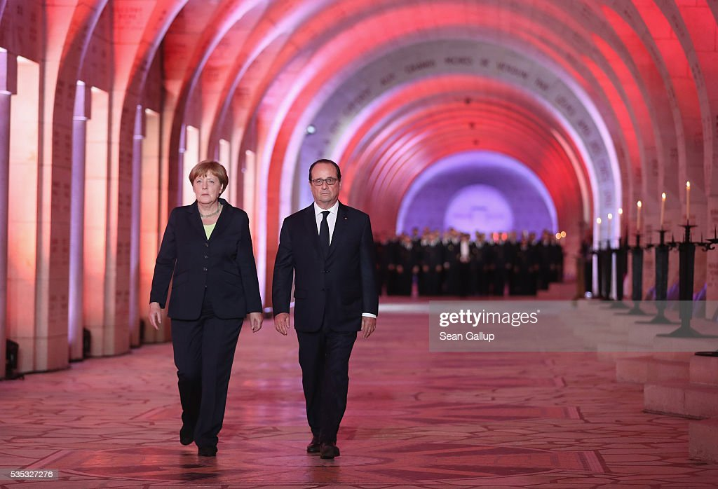 French President Francois Hollande and German Chancellor Angela Merkel arrive to light an eternal flame inside the ossuary at Douaumont in memory of the 130,000 soldiers whose remains are buried at the site during ceremonies to commemorate the 100th anniversary of the World War I Battle of Verdun on May 29, 2016 near Verdun, France. The 1916, 10-month battle pitted the French and German armies against one another in a grueling campaign of trench warfare and artillery bombardments that killed a total of approximately 300,000 soldiers. The events today coincide with the 50th anniversary of commemorations held at Verdun by then French President Charles de Gaulle and German Chancellor Konrad Adenauer that paved the way for a new era of peaceful, post-war Franco-German relations.