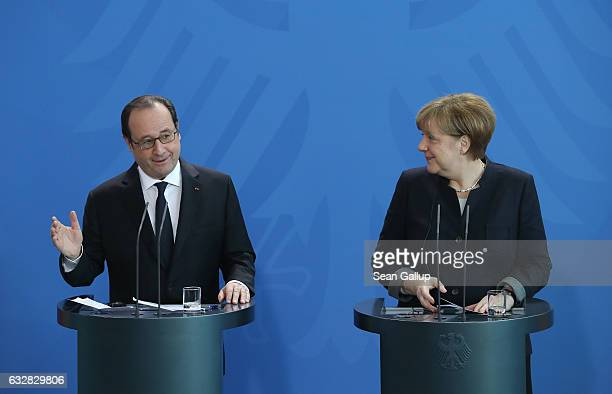 French President Francois Hollande and German Chancellor Angela Merkel speak to the media prior to talks at the Chancellery on January 27 2017 in...
