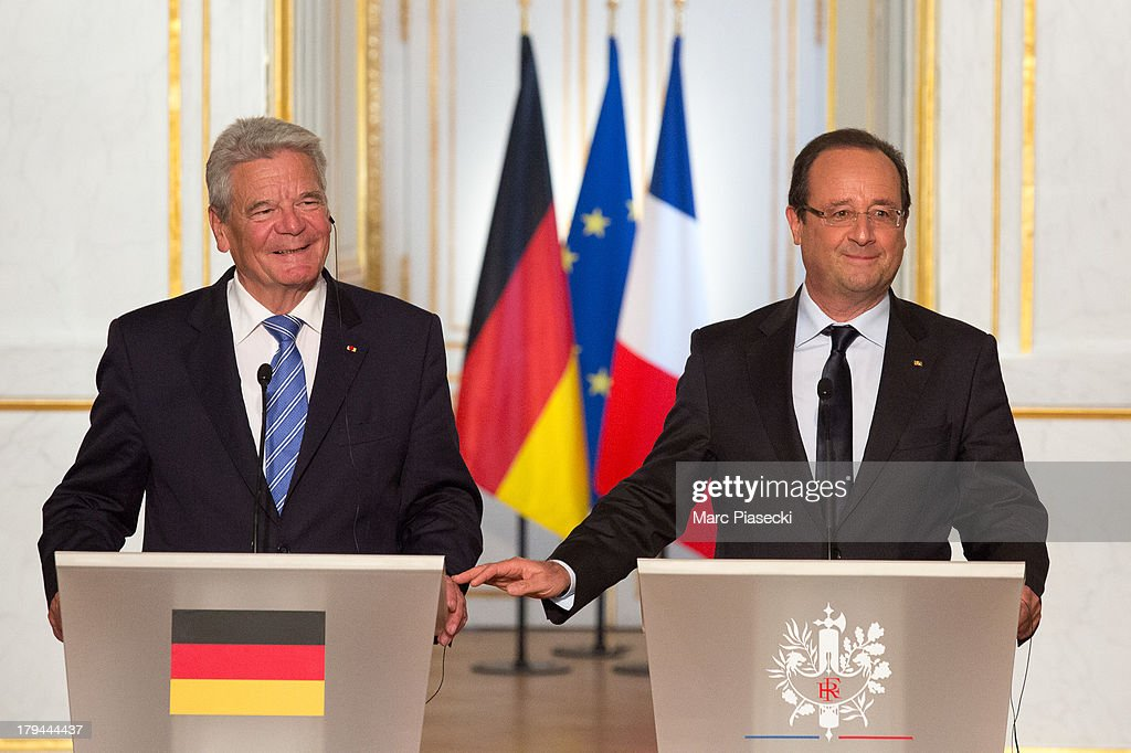 French president Francois Hollande and German President <a gi-track='captionPersonalityLinkClicked' href=/galleries/search?phrase=Joachim+Gauck&family=editorial&specificpeople=2077888 ng-click='$event.stopPropagation()'>Joachim Gauck</a> attend a press conference at the Elysee Palace on September 3, 2013 in Paris, France. The German President is in France for a 3 day state visit.