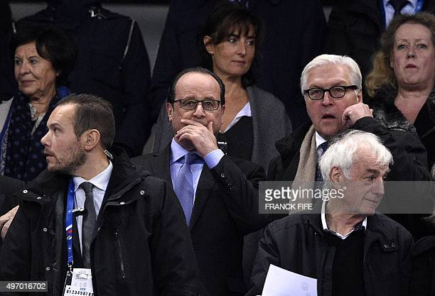 French President Francois Hollande and Germany's Foreign Minister FrankWalter Steinmeier attend a friendly international football match between...