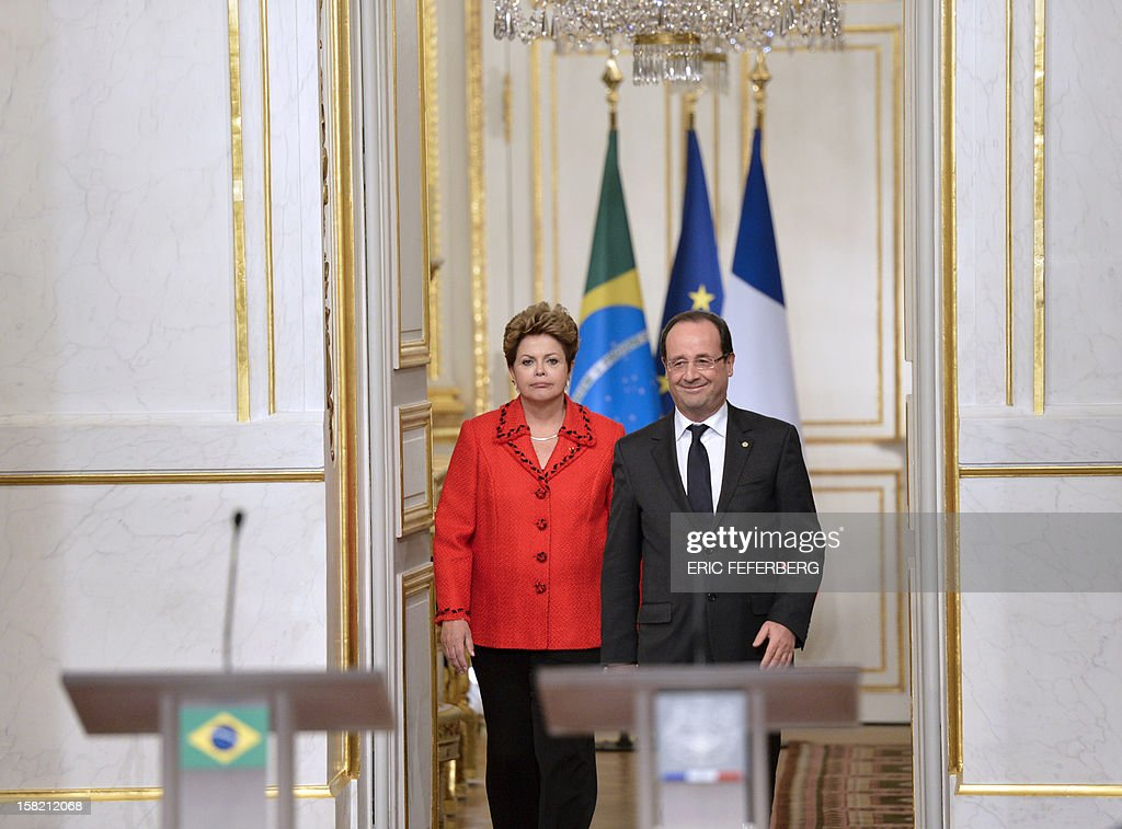 French President Francois Hollande (R) and his Brazilian counterpart Dilma Rousseff arrive, on December 11, 2012, to give a joint press conference at the Elysee presidential palace in Paris. Brazilian President Dilma Rousseff kicked off her first official visit to France, where a decision on whether she will choose Rafale fighter jets or opt for another aircraft is keenly awaited. During the two-day trip Rousseff will have talks with French counterpart Francois Hollande on the eurozone crisis -- on which she has criticized EU austerity measures -- bilateral trade and wider matters of global concern.