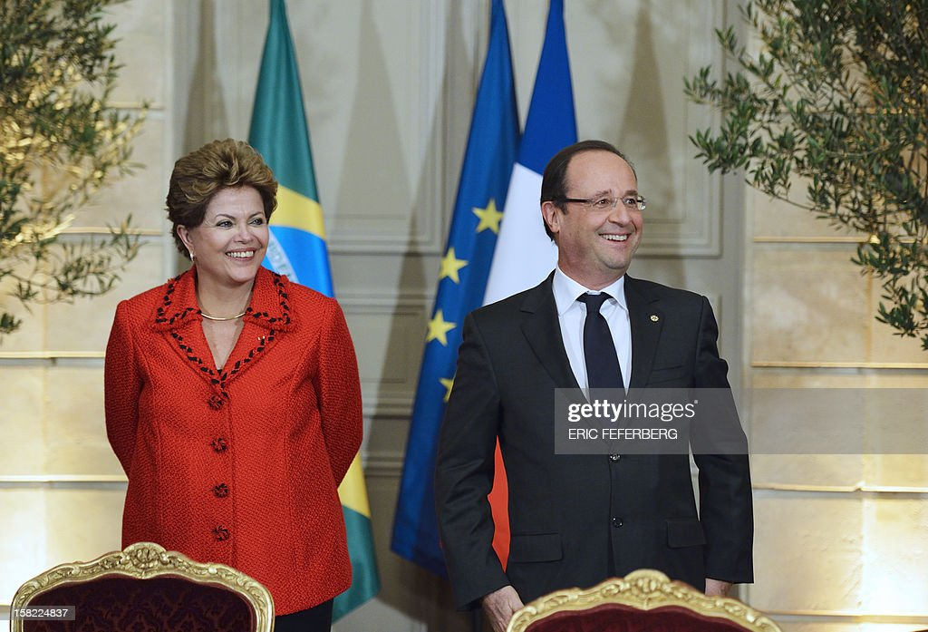 French President Francois Hollande (R) and his Brazilian counterpart Dilma Rousseff react, on December 11, 2012, during an agreement signature ceremony at the Elysee presidential palace in Paris. During her first official two-day visit to France, Brazilian President Dilma Rousseff will have talks with French counterpart Francois Hollande on the eurozone crisis -- on which she has criticized EU austerity measures -- bilateral trade and wider matters of global concern.