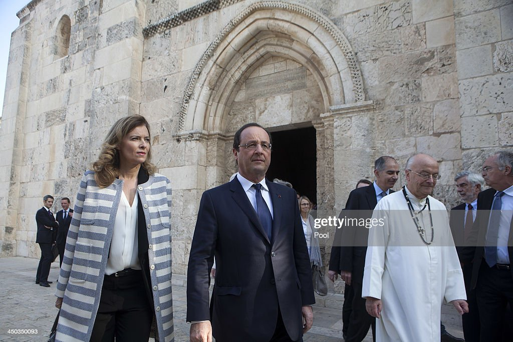 French President Francois Hollande and his companion Valeria Trierweiler, accompanied by Father Frans Bouwen (R) from the White Order visit the Saint Anna Church in the Old CIty of Jerusalem on November 18, 2013 in Jerusalem,. The Crusader church marks the traditional site of the home of Jesus' maternal grandparents, Anne and Joachim, and the birthplace of the Virgin Mary. President of France Francois Hollande is on a three day official visit to Israel and the West Bank.