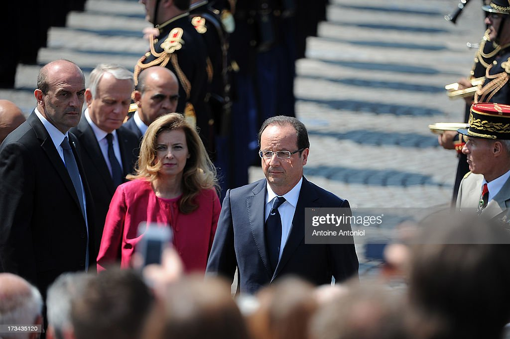 French President Francois Hollande and his companion <a gi-track='captionPersonalityLinkClicked' href=/galleries/search?phrase=Valerie+Trierweiler&family=editorial&specificpeople=8534231 ng-click='$event.stopPropagation()'>Valerie Trierweiler</a> attend the Bastille Day parade on the Champs Elysees on July 14, 2013 in Paris, France. The annual military ceremony is the largest in Europe remembering the 'Fete de la Federation' for 1790.