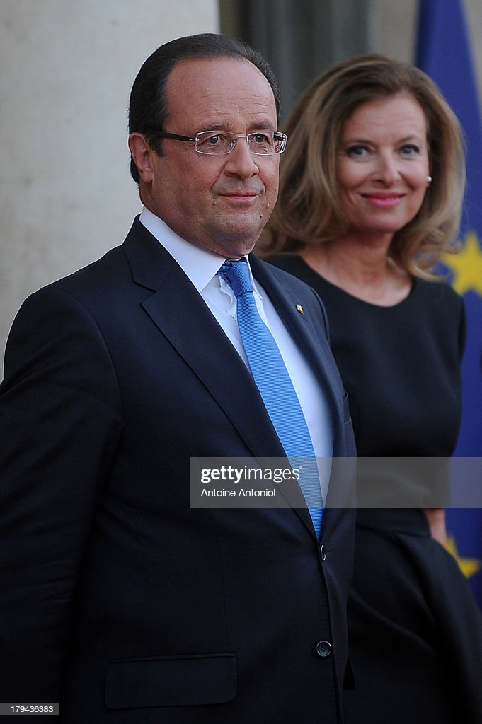 French President Francois Hollande (L) and his companion <a gi-track='captionPersonalityLinkClicked' href=/galleries/search?phrase=Valerie+Trierweiler&family=editorial&specificpeople=8534231 ng-click='$event.stopPropagation()'>Valerie Trierweiler</a> wait for the German President and his companion at the Elysee Palace on September 3, 2013 in Paris, France. The German President is in France for a 3 day state visit.