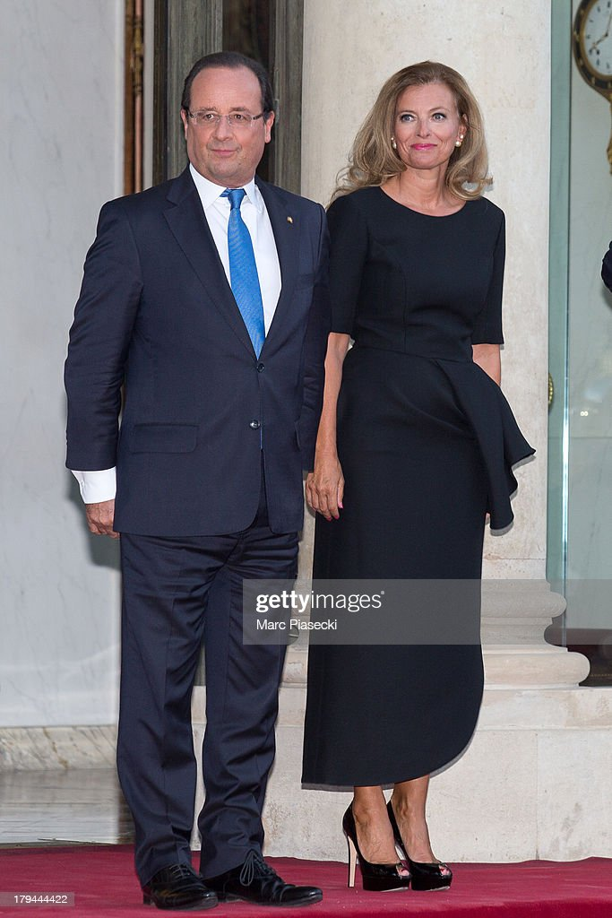 French President Francois Hollande and his companion <a gi-track='captionPersonalityLinkClicked' href=/galleries/search?phrase=Valerie+Trierweiler&family=editorial&specificpeople=8534231 ng-click='$event.stopPropagation()'>Valerie Trierweiler</a> wait for the German President's companion Daniela Schadt and the German President Joachim Gauck at the Elysee Palace on September 3, 2013 in Paris, France. The German President is in France for a 3 day state visit.