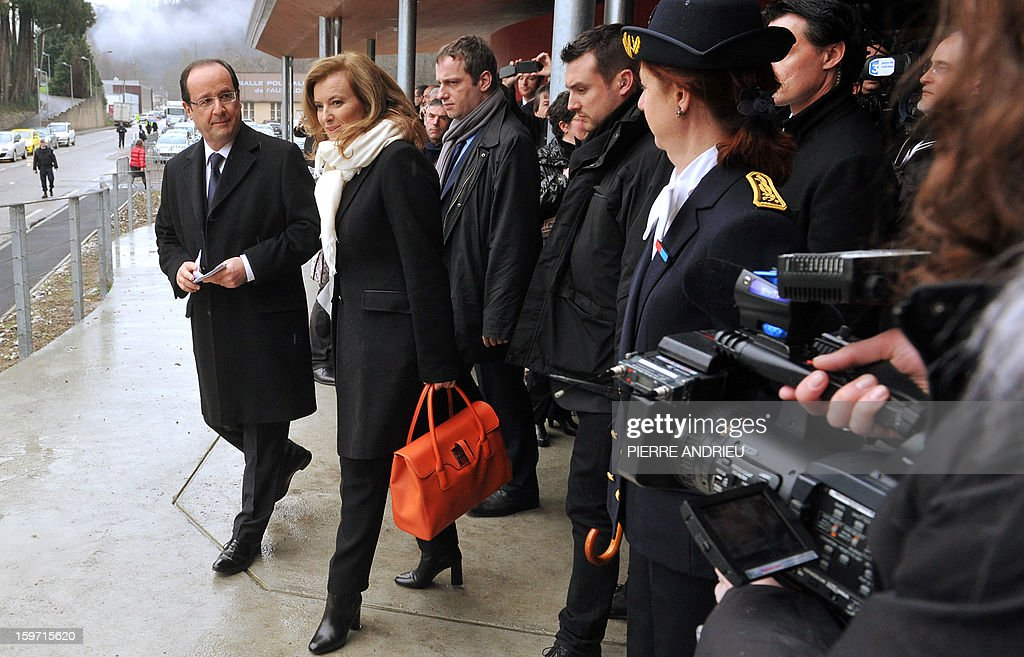 French President Francois Hollande (L) and his companion Valerie Trierweiler (2L) walk during the inauguration of a community hall in Auzelou a Tulle, Correze region central France on January 19, 2013. AFP PHOTO / PIERRE ANDRIEU
