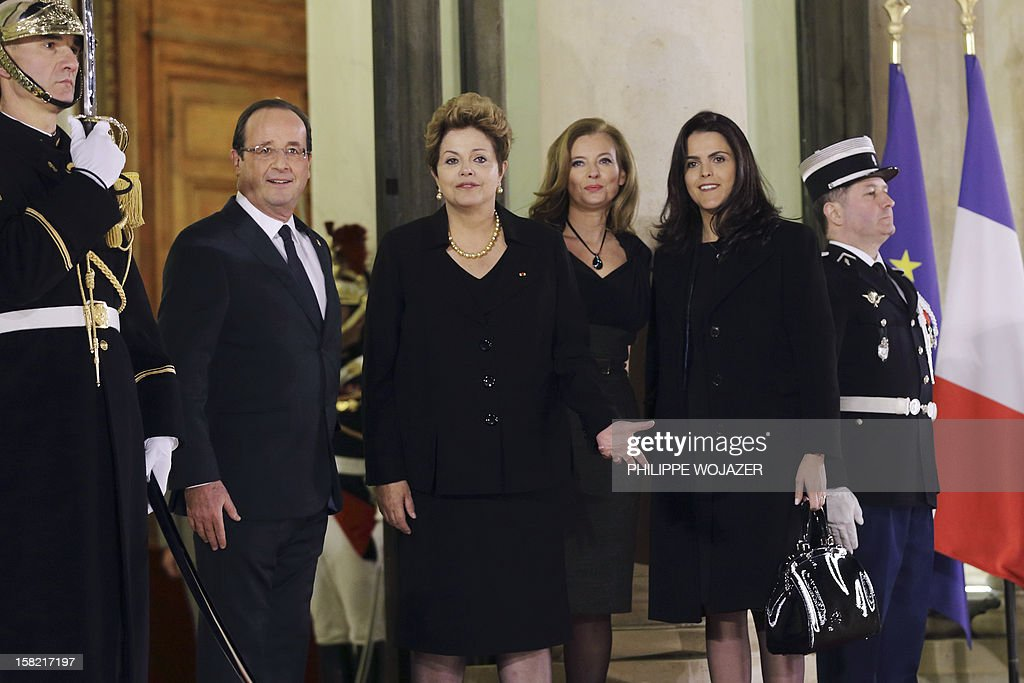 French President Francois Hollande (L) and his companion Valerie Trierweiler (2ndR) welcome Brazil's President Dilma Rousseff (2ndL) and her daughter Paula Araujo for a state dinner at the Elysee Palace in Paris on December 11, 2012.