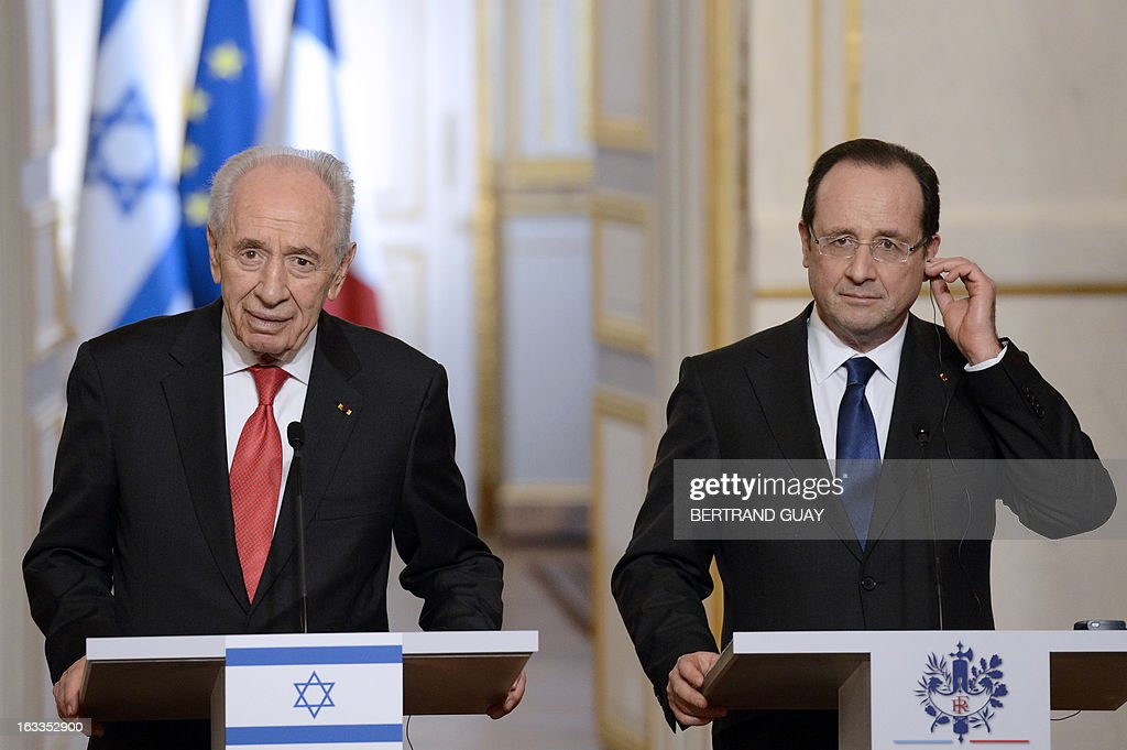 French President Francois Hollande and his Israeli counterpart Shimon Peres hold a press conference at the Elysee presidential palace on March 8, 2013 in Paris AFP PHOTO BERTRAND GUAY