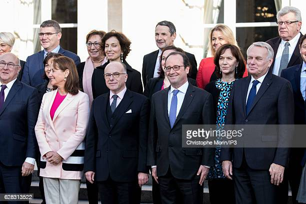 French President Francois Hollande and his ministers including new Frence Prime Minister Bernard Cazeneuve pose for a family portrait one day after...