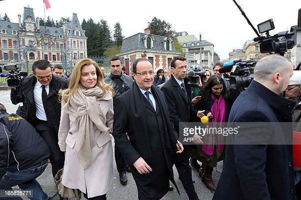 French President Francois Hollande and his partner Valerie Trierwieler leave after an award ceremony at the prefecture in Tulle southern France on...