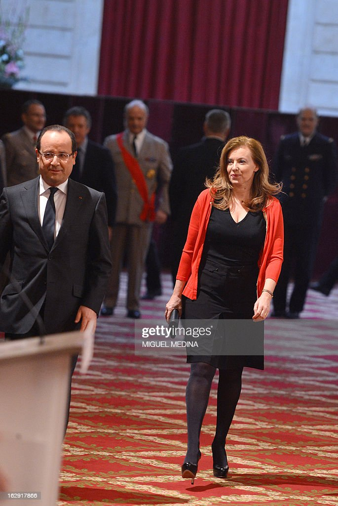 French President Francois Hollande, and his partner Valerie Trierweiler walk to attend a ceremony for the medalist of the 2012 London olympics games, on March 1, 2013 in Paris.