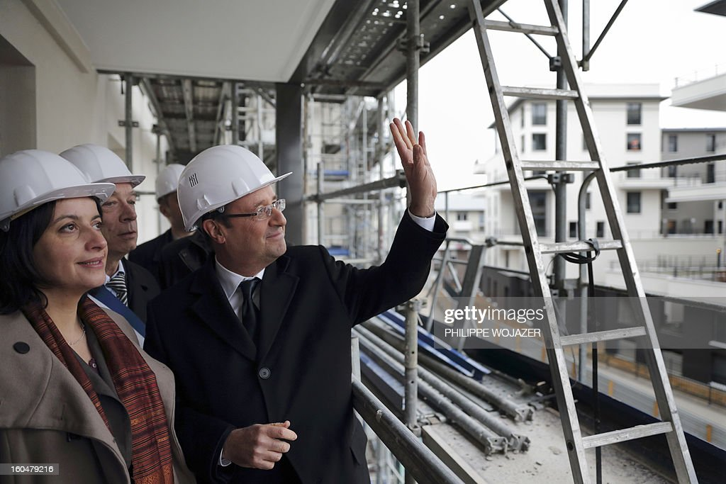 French President Francois Hollande and Housing and Equality of Territories minister Cecile Duflot visit housing constructions at an urban redevelopment site in Ermont-Eaubonne near Paris on February 1, 2013. POOL