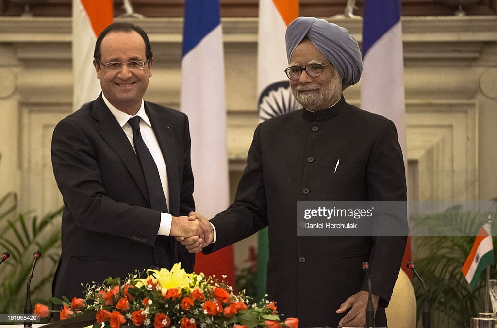 French President Francois Hollande and Indian Prime Minister <a gi-track='captionPersonalityLinkClicked' href=/galleries/search?phrase=Manmohan+Singh&family=editorial&specificpeople=227120 ng-click='$event.stopPropagation()'>Manmohan Singh</a> shake hands after the signing of agreements at Hyderabad House on February 14, 2013 in New Delhi, India. French President Francois Hollande arrived in India on Thursday for a two-day trip, his first to Asia since becoming President last year and hopes to build the way for important trade contracts.