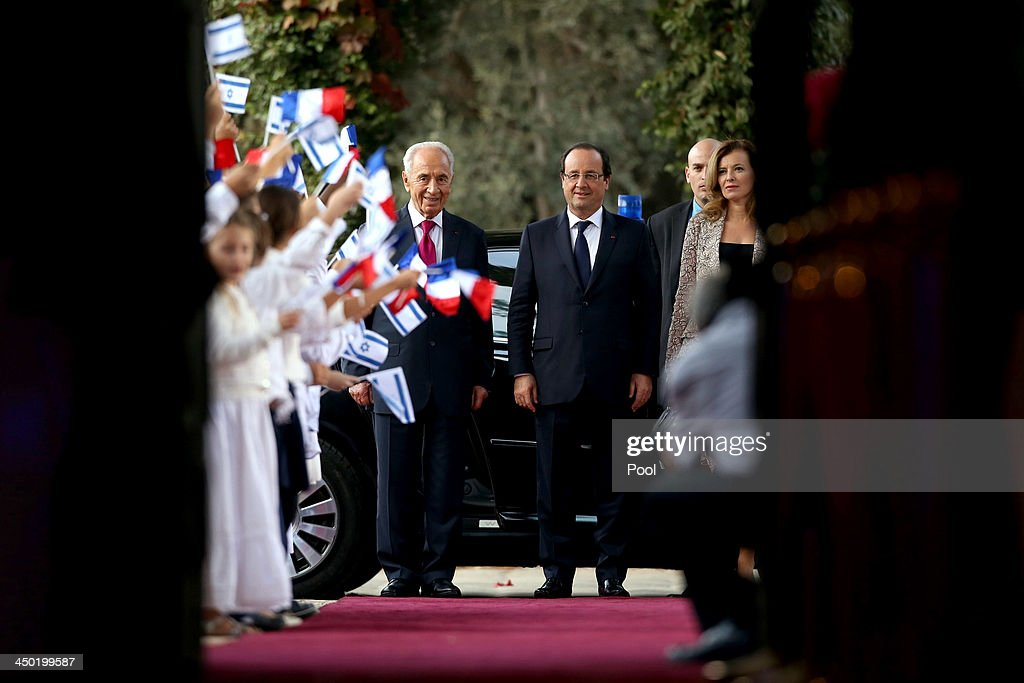 French president Francois Hollande (R) and Israeli President <a gi-track='captionPersonalityLinkClicked' href=/galleries/search?phrase=Shimon+Peres&family=editorial&specificpeople=201775 ng-click='$event.stopPropagation()'>Shimon Peres</a> (L) during a welcome ceremony for the French president at the Israeli president's residence on November 17, 2013 in Tel Aviv, Israel. Hollande landed at Israel's Ben Gurion airport for a three-day visit in Israel and the West Bank.